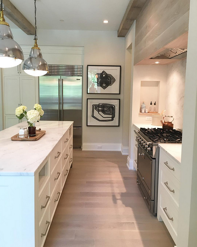 "Cabinet paint color is Benjamin Moore OC-17 White Dove. Floors are 6"" white oak floors. white-dove-by-benjamin-moore-kitchen-white-oak-hardwood-floor-and-limewashed-wood-kitchen-hood Kate Marker Interiors"