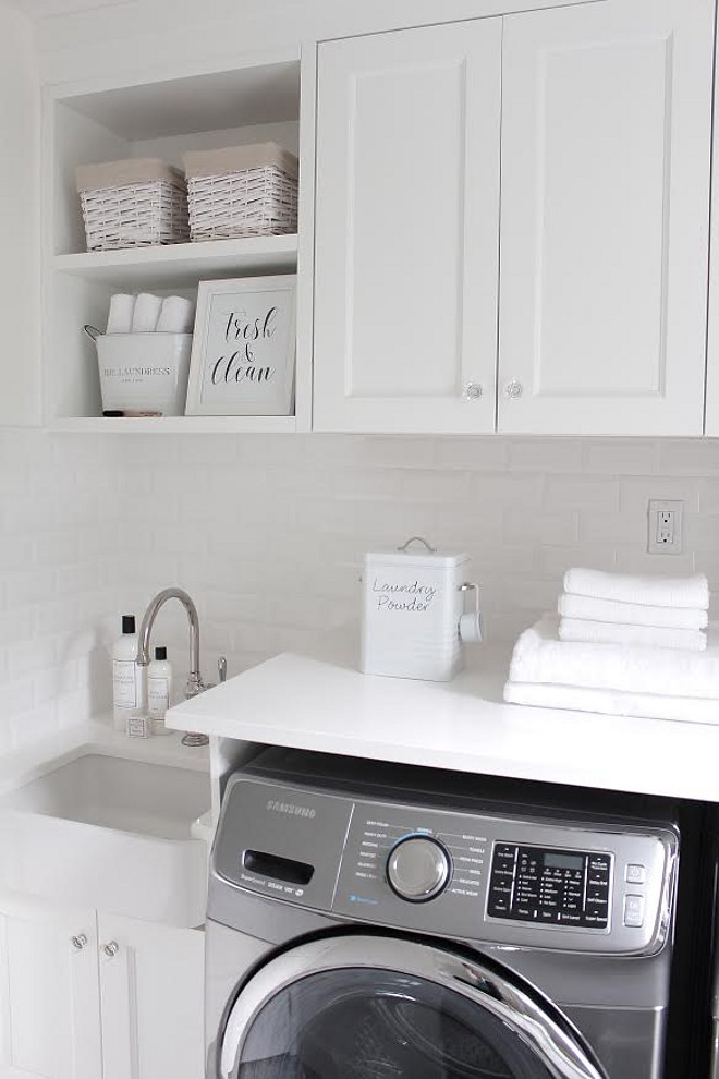 white-laundry-room-with-grey-washer-and-dryer JShomedesign via Instagram.