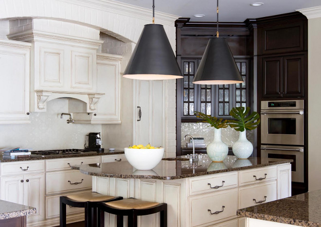 White ivory kitchen cabinet paint color. white-ivory-kitchen-and-dark-stained-wet-bar-cabinet-white-ivory-kitchen-and-dark-stained-wet-bar-cabinet-paint-color #Whiteivorykitchen #darkstainedcabinet #wetbar #cabinet #kitchen Beautiful Homes of Instagram