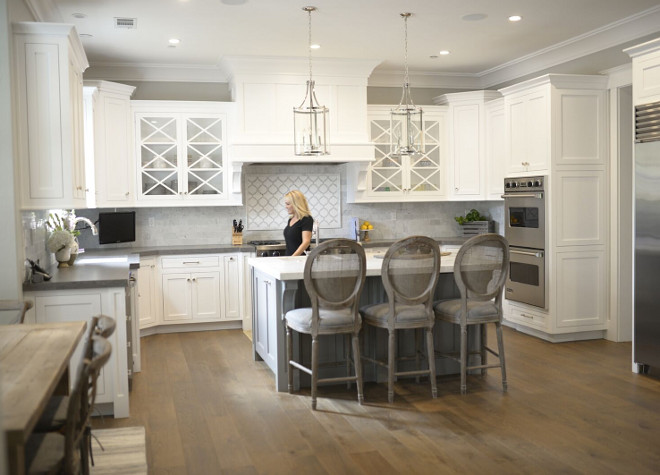 White kitchen with white oak floor. White kitchen with grey island and white oak flooring. Popular kitchen design look, white cabinets, grey island and white oak floos. #Whitekitchen #greyisland #whiteoakfloor #kitchenwhiteoakfloor #whiteoakflooring  white-kitchen-with-white-oak-floor Eye for the Pretty.