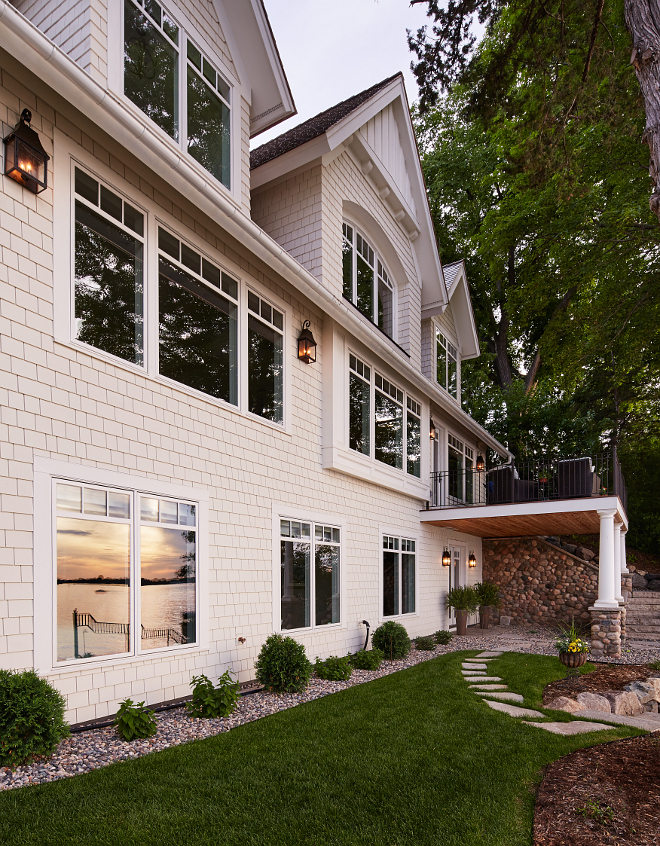 Single home exterior paint color. The exterior feature custom stained shakes. #homeexterior #customstainedshakes #shingle Vivid Interior Design. Hendel Homes