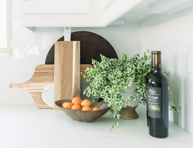 Wood and Marble on kitchen countertop. New kitchen trend. One of the latest kitchen trends is stacking wood and marble boards on the countertop. They add texture and a casual look to any kitchen #kitchen #kitchentrends #woodboard #marbleboard Pure Salt Interiors