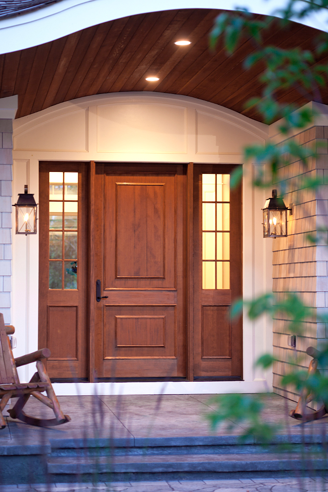 Wood front door and wood tongue and groove porch ceiling. Gorgeous custom wood front door. Notice the tongue and groove porch ceiling.  wood-front-door-and-wood-tongue-and-groove-porch-ceiling #porch #wooddoor #frontdoor #woodfrontdoor #tongueandgroove #porchceiling Vivid Interior Design. Hendel Homes