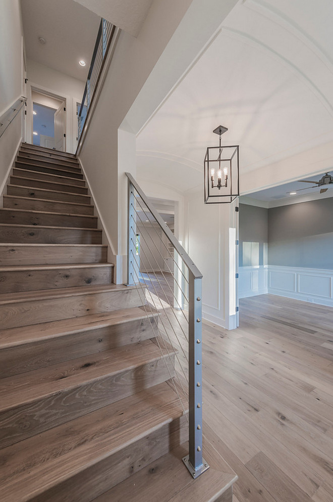 Barrel Ceiling Foyer with steel cable railing staircase and wide plank oak floors. Floor is Chesapeake Flooring White Oak, Provence Manor Outback. barrel-ceiling-foyer-with-stainless-cable-railing-staircase-and-wide-plank-oak-floors #BarrelCeiling #BarrelCeilingFoyer #Foyer #steelcablerailing #staircase #wideplank #oakfloors Cottage Home Company