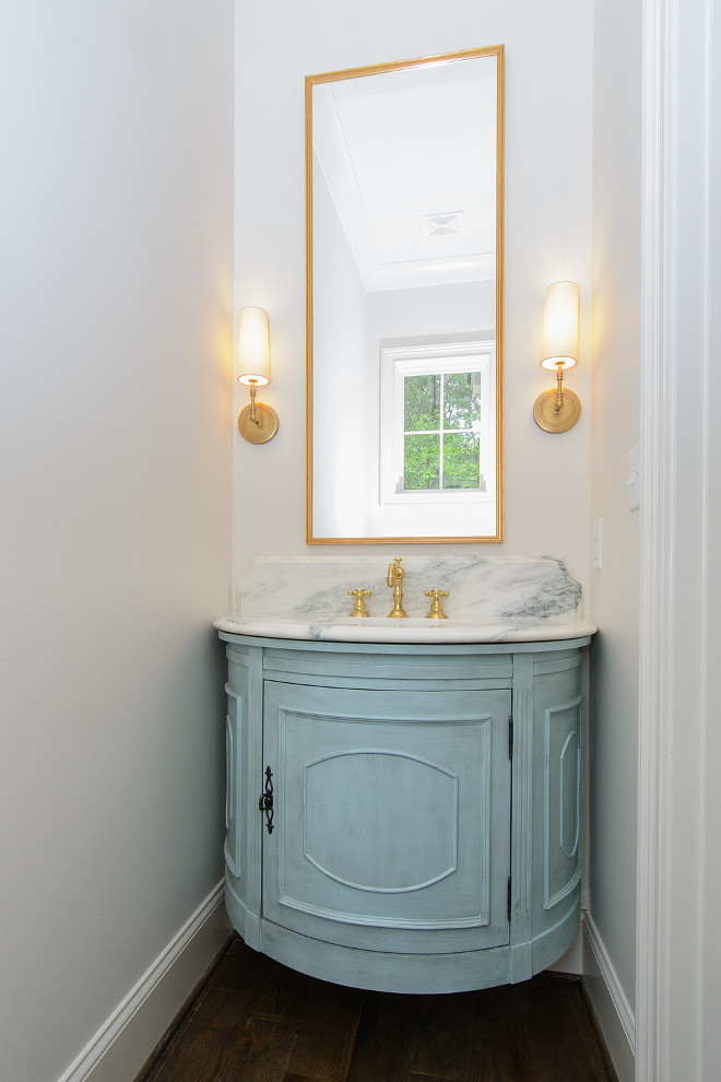 "Bathroom Blue Cabinet Paint Color. Turquoise Blue Half Moon Floating Washstand with Tall Brass Mirror. I asked the designer about the color used on this bathroom cabinet and I was very surprised with what she told me about this cabinet. What a brilliant idea! ""Actually, this is not a custom piece, this was the Tucci cabinet by SteinWorld found on Wayfair for $569.99! Since this was going in a speculative build, I wanted to maximize investment dollars. Our cabinet maker wanted to charge over $3,000 for a demilune design, so this was used instead"". Isn't she smart?! Bathroom Blue Cabinet Paint Color. Bathroom Blue Cabinet Paint Color #Bathroom #BlueCabinet #PaintColor bathroom-blue-cabinet-paint-color Tasha B. Davis Interiors, LLC."