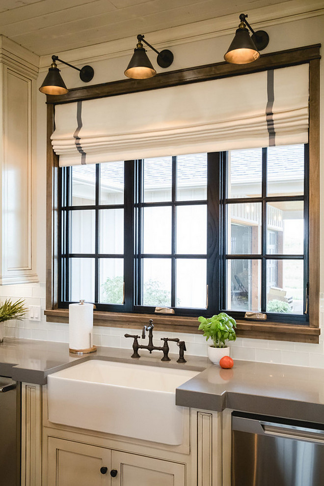 Black Kitchen Window. Kitchen features a black window above sink and three wall sconces. #kitchen #blackwindow #kitchenwindow #blackkitchenwindow Alicia Zupanblack-kitchen-window