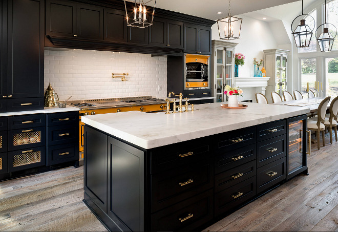 Black kitchen cabinets. Black kitchen cabinets. Black kitchen cabinets with white marble countertop and rustic wide plank wood floor. #Blackkitchen #Blackkitchencabinets black-kitchen-cabinets #rusticwood #rusticwoodfloor #reclaimedwoodfloor Marc Levack. Deborah Scannell Photography