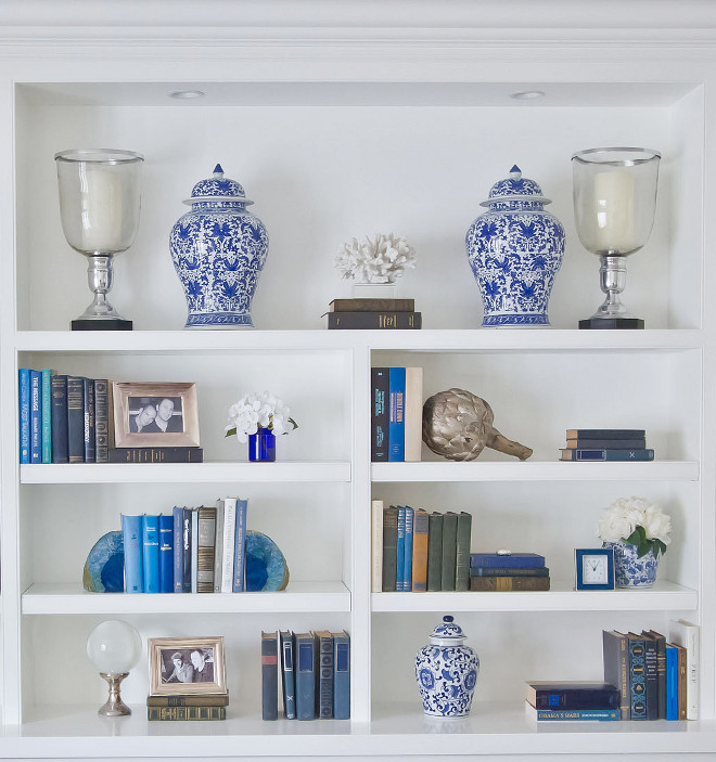 Blue and white bookshelf styling. The custom built-ins you see serve as a kind of accessory wall for us. We love the elegant Japanese Ginger jars, accentuated with smaller complementary items in neutral hues. The built-in color is Benjamin Moore Simply White. #Bookshelf #blueandwhiteblookshelf #benjaminmooresimplywhite Home Bunch Beautiful Homes of Instagram Bryan Shap @realbryansharpblue-and-white-bookshelf-styling