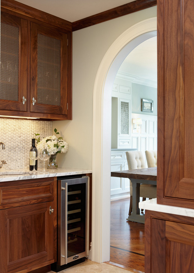 Butler's pantry. Butlers pantry cabinet. Butlers pantry cabinet and archway. #Butlerspantry #cabinet #Butlerspantrycabinet butlers-pantry Merrick Construction, Inc.