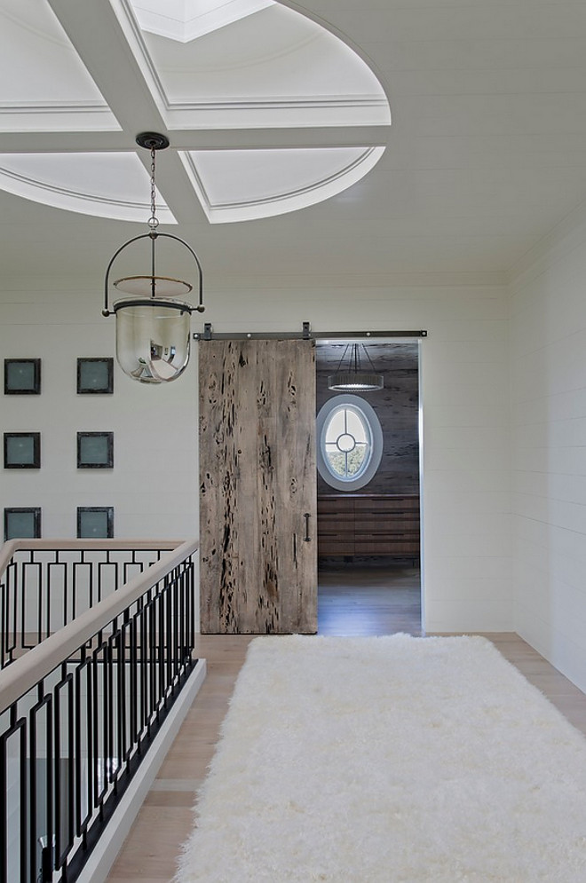 Catwak with skylight and Lighting is Urban Electric Smokebell Pendant. Notice the Pecky Cypress barn door. catwalk-with-shiplap-walls-custom-stairway-railing-skylight-and-pecky-cypress-barn-door Herlong & Associates Architects + Interiors