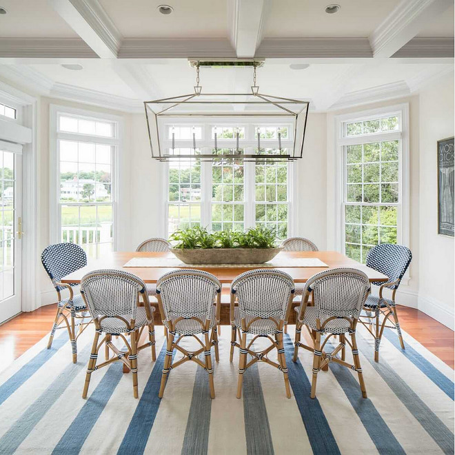 Darlana linear chandelier. This coastal dining area features a Darlana Linear Chandelier from Visual Comfort and bistro chairs from Serena & Lily. #DarlanaLinearChandelier #Darlana #linearChandelier #VisualComfort darlana-linear-chandelier-from-visual-comfort Design № Five