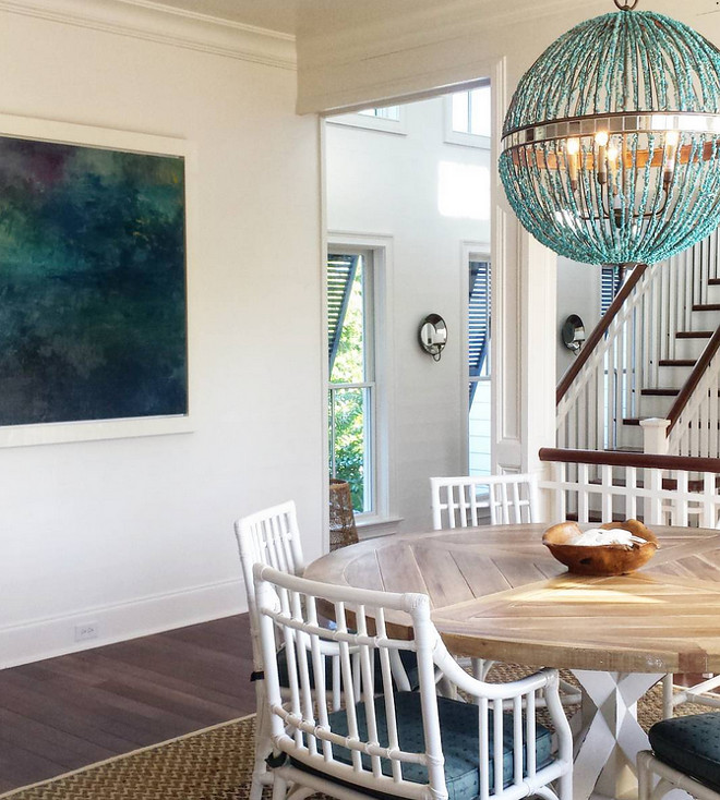 Dining room turquoise chandelier. Chandelier is Alberto Orb Chandelier from Currey & Co. #turquoisechandelier #turquoise #chandelier #diningroom Image: @kialynea via Instagram