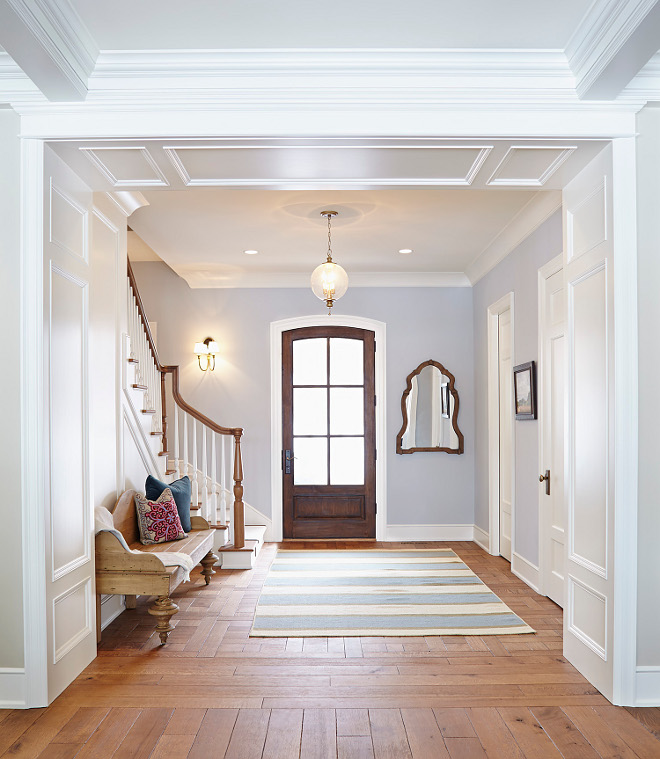 Entry. Entry decor. Entry bench. Entry flooring. Entry millwork. Entry lighting. Lighting is from Hinkley. Sconces are Visual Comfort Eric Cohler Venetian 2 Light Sconce in Hand-rubbed antique brass. #Entry entry Hendel Homes