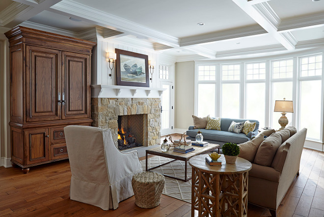 Family Room. Neutral Family Room. The spacious living room features coffered ceiling, floor-to-ceiling windows and a custom walnut media cabinet. Family Room #FamilyRoom family-room Hendel Homes