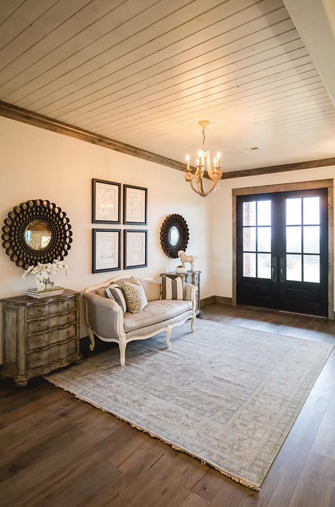 Farmhouse Foyer. Farmhouse Foyer with tongue and groove ceiling and black front doors. #Farmhouse #Foyer #FarmhouseFoyer #Tongueandgroove #ceiling #Blackdoor Alicia Zupan