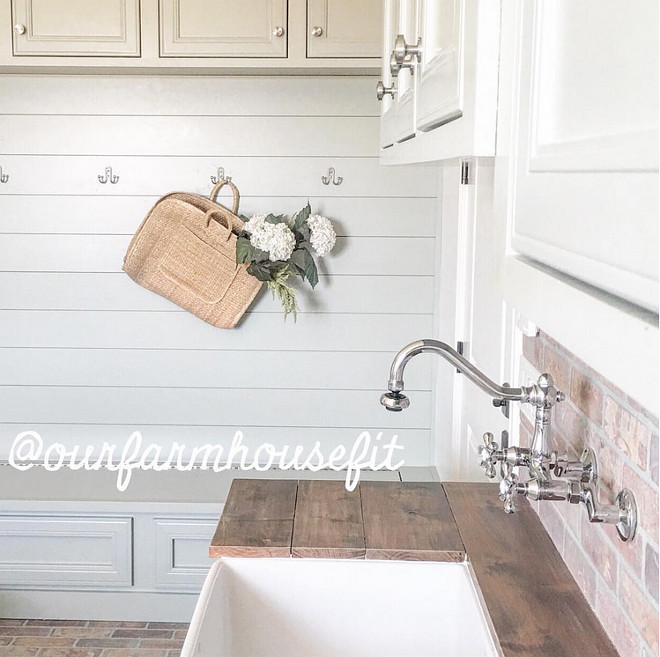 Farmhouse laundry room mudroom. Farmhouse laundry room mudroom with reclaimed plank countertop, shiplap walls and brick flooring. #Farmhouse #Farmhouselaundryroom #Farmhousemudroom #reclaimedplank #countertop #shiplap #brick #flooring farmhouse-laundry-room-mudroom Home Bunch's Beautiful Homes of Instagram ourfarmhousefit