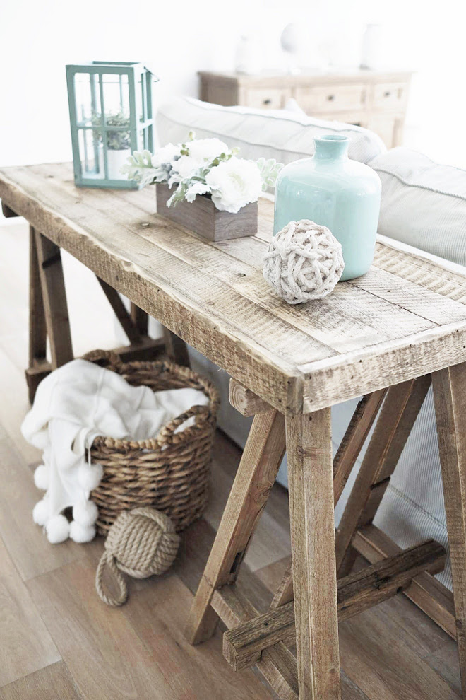 Sofa table. Farmhouse, rustic sofa table. You can have a sofa table even if you don't have floor outlets. Instead of using lamps, add one lantern (or a pair) and a vase. Remember to keep it symmetrical. #sofatable #sofatabledecor #homedecor #interiors Beautiful Homes of Instagram @nc_homedesign via Home Bunch