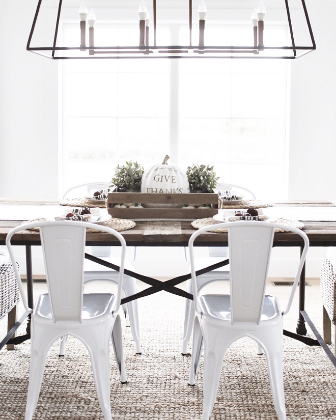 The Tolix style white chairs are from Walmart. Farmhouse dining room with Tolix style white chairs are from Walmart. #farmhouse #tolixstylechairs #whitetolix Beautiful Homes of Instagram @nc_homedesign via Home Bunch
