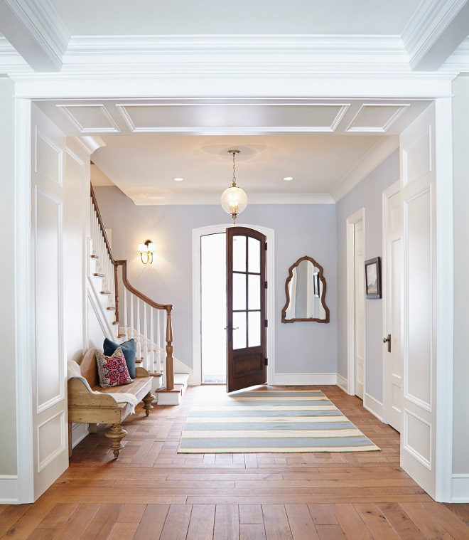 Foyer. This crisp foyer is painted in Gray Screen by Sherwin Williams and the millwork is painted in Icicle by Benjamin Moore. #Foyer #Millwork #paintcolor #GrayScreenSherwinWilliams #IcicleBenjaminMoore foyer Hendel Homes