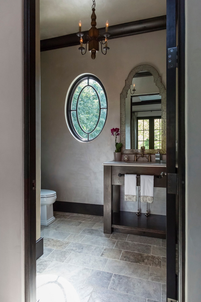 French Bathroom. Powder room features a custom Oak vanity. Countertop is honed granite. Chandelier is Currey and Co. Knotworth Chandelier. #Frenchbathroom #bathroom #powderroom Hendel Homes