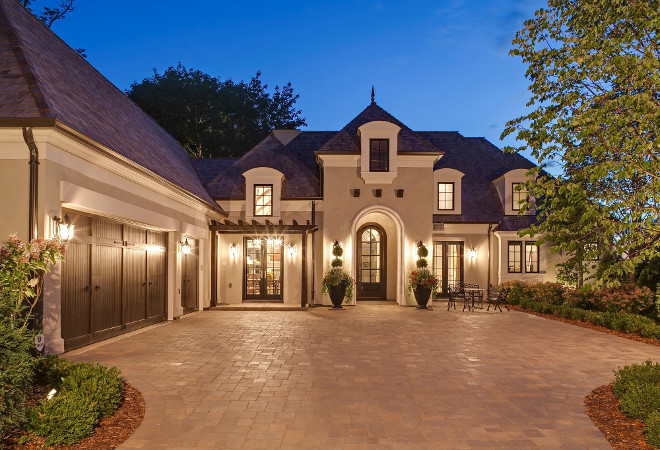 French Home Exterior. This French home has an incredible curb-appeal! I love the slate roof and the wood garage doors. #Frenchhome #Frenchhomeexterior #homeExterior french-home-exterior-ideas Hendel Homes