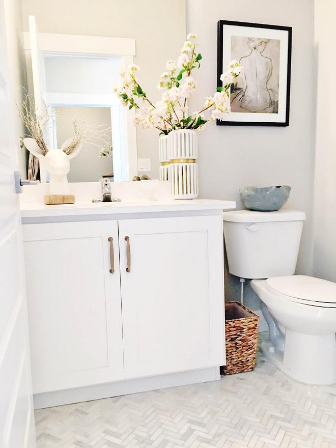 Herringbone Tile. Bathroom Herringbone Tile. Herringbone Tile. The half-bath floors are Herringbone Marble Winter Sky Allen and Roth with white grout. #bathroomHerringboneTile #HerringboneTile herringbone-tile Home Bunch's Beautiful Homes of Instagram janscarpino