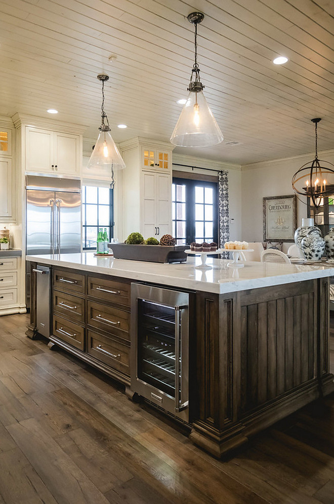 Island Stain Color. Kitchen island and hood features a tobacco stain. The islands and hood were stained in Tobacco and glazed with VanDyke brown glaze. #IslandStainColor island-stain-color #Tabaccostaincolor Alicia Zupan
