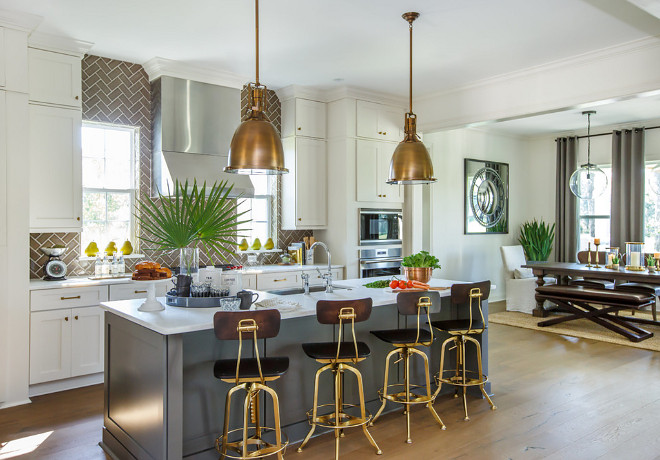 Kitchen with brass accents. Kitchen pendant lights and bass stools are from Restoration Hardware. #kitchen #brass #pendantlights #barstools kitchen-brass-accents Cottage Home Company