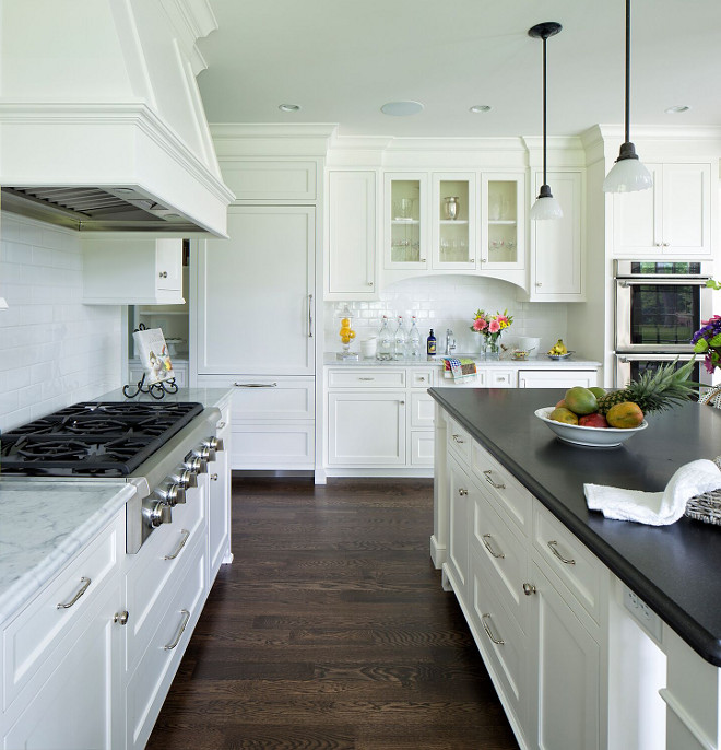 "Kitchen Flooring. Kitchen Flooring. Wood flooring is 4"" white oak with custom dark stain similar to 50/50 mix of Minwax Ebony and Jacobean. Dark Kitchen Flooring Stain #KitchenFlooring #Darkkitchenflooringstain #KitchenFlooring Hendel Homes"