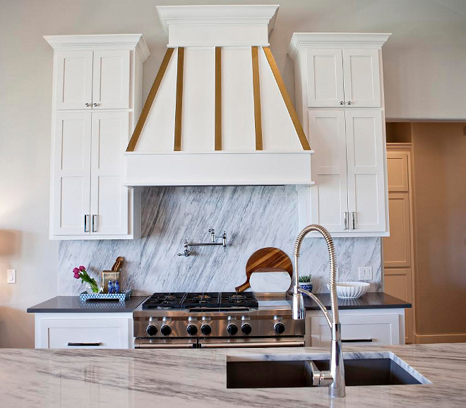 Hood. Kitchen hood. The hood range is accented beautifully in white and gold. kitchen-hood #kitchen #hood #range #hood Ivy House Interiors