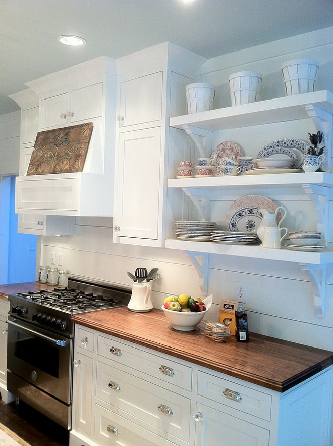 Small Farmhouse Kitchen. Small Farmhouse Kitchen. Small Farmhouse Kitchen with white cabinets, wide plank backsplash and open selves. Countertop is solid walnut countertop. No stain at all. Clear coated. #Farmhousekitchen #smallfarmhouse #kitchen #farmhouse #smallkitchens #plankbacksplash #wideplank #wideplankbacksplash Renew Properties