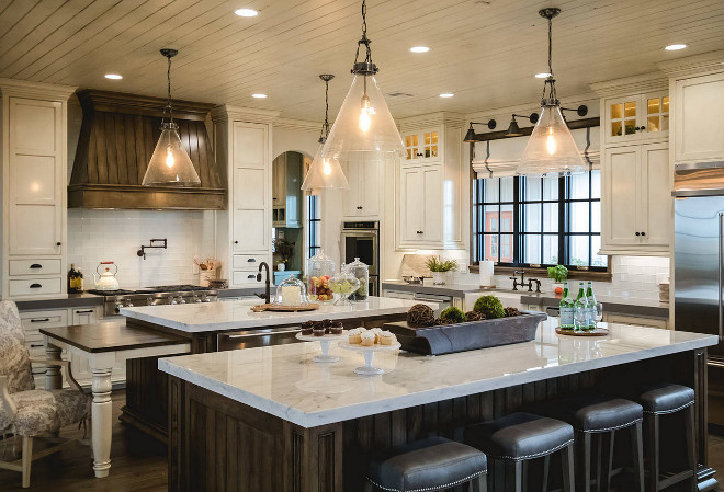 Farmhouse kitchen with two islands. White farmhouse kitchen with dark stained hood and two dark stained islands. The kitchen cabinets were Benjamin Moore White Dove with Vandyke glaze. Farmhouse kitchen with two islands #Farmhousekitchen #twoislands #twoislandskitchen #darkstainedisland #darkstainedhood #kitchen #farmhousekitchens Alicia Zupan