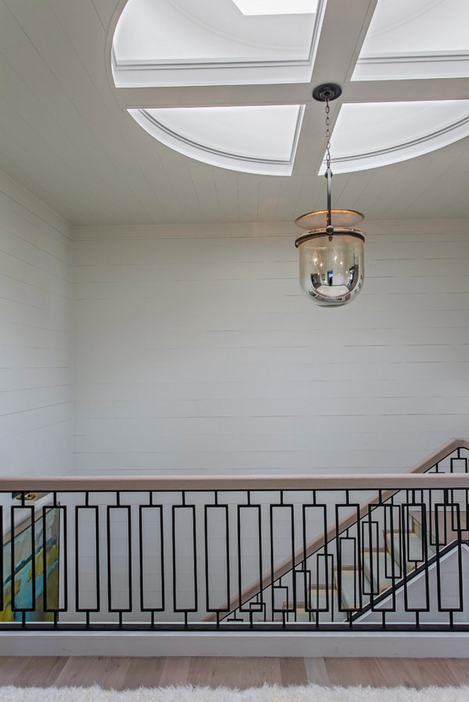 Urban Electric Smokebell Pendant. The staircase features a beautifully designed custom railing. Lighting is Urban Electric Smokebell Pendant. #UrbanElectric #SmokebellPendant Herlong & Associates Architects + Interiors