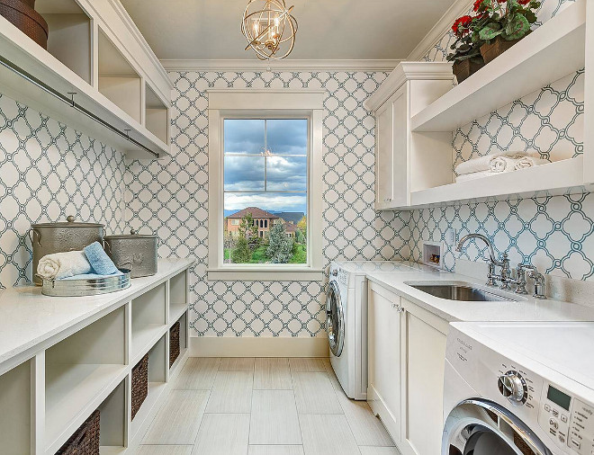 Laundry Room. Laundry room features neutral floor tile, off-white cabinets with crystal knobs and white quartz countertop. Laundry room also features a blue and white trellis wallpaper. laundry-room