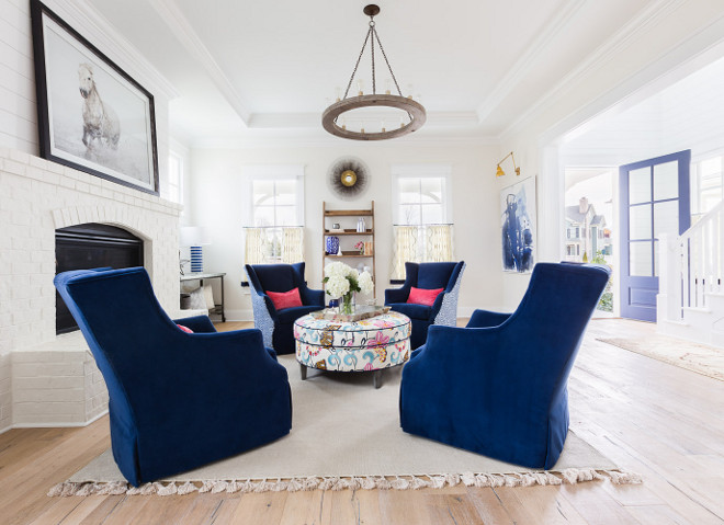 Blue and white living room. Blue and white living room with painted brick fireplace, white shiplap and light hardwood floor. #bluenadwhite #blueandwhitelivingroom #livingroom Blue and white living room. Redo Home and Design