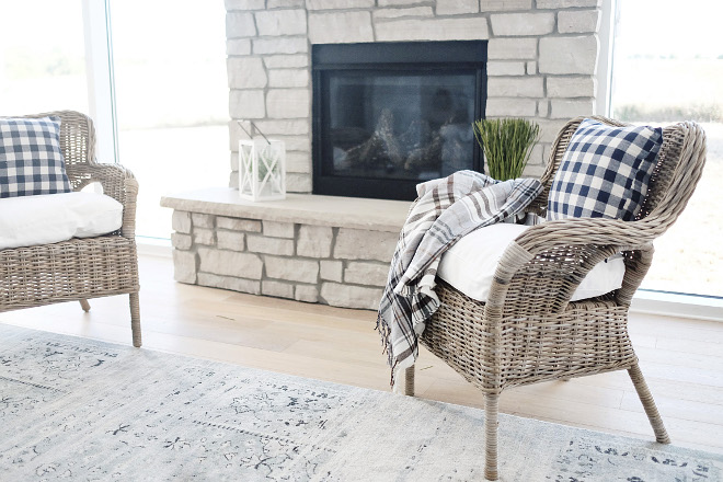Living room chairs. Comfy wicker chairs add some texture and comfort by the stone fireplace. #livingroom #chairs #wickerchairs #wicker #livingroomchairs Beautiful Homes of Instagram @nc_homedesign via Home Bunch