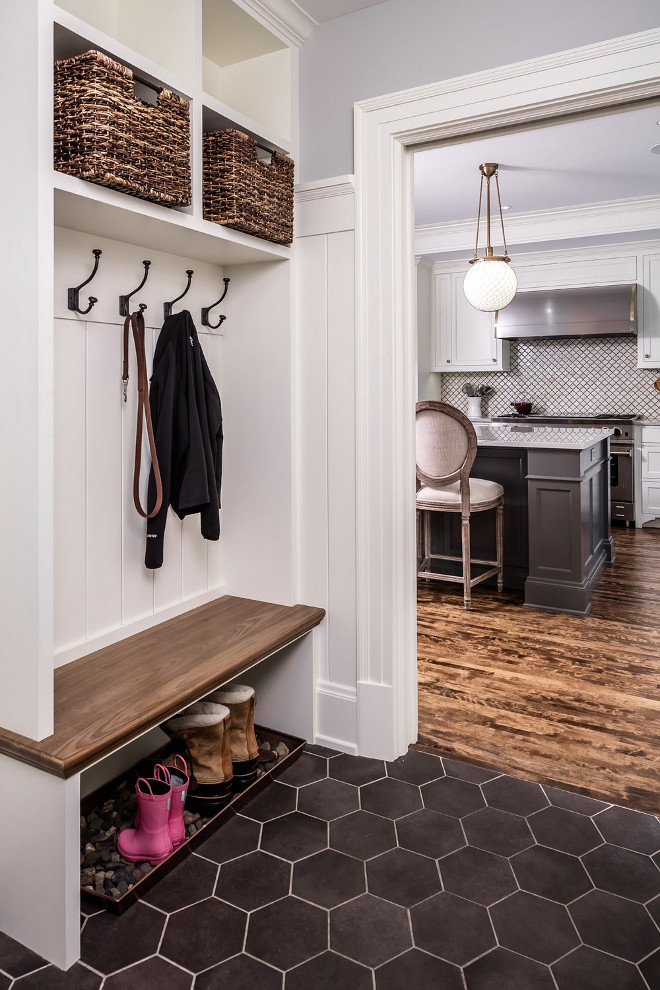 "Mudroom. Small Mudroom. Small mudroom dimensions and flooring. The mudroom bench top is 1 1/4"" thick. The side walls of the cubbies are 1 1/2"" but made from 3/4"" wood. The back is 3/4"" V-groove with a custom width. The large hex floor tile is SomerTile Textilis Hex Porcelain Floor and Wall Tile, Black. #mudroom #hexflooring #largehextile #mudrooms #smallmudroom Quartersawn Design Build"