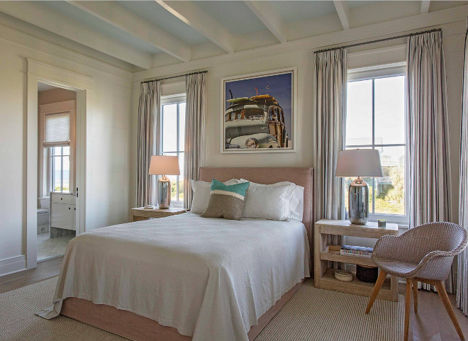 Neutral coastal bedroom. This bedroom features a gentle color palette, which is perfect for a seaside home. #bedroom #colorpalette #bedrooms neutral-coastal-bedroom Herlong & Associates Architects + Interiors