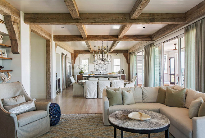 Reclaimed beams. Reclaimed beams continues from the kitchen to the living room area. Open layout with reclaimed beams. #Openlayout #reclaimedbeams #ceilingbeams Herlong & Associates Architects + Interiors