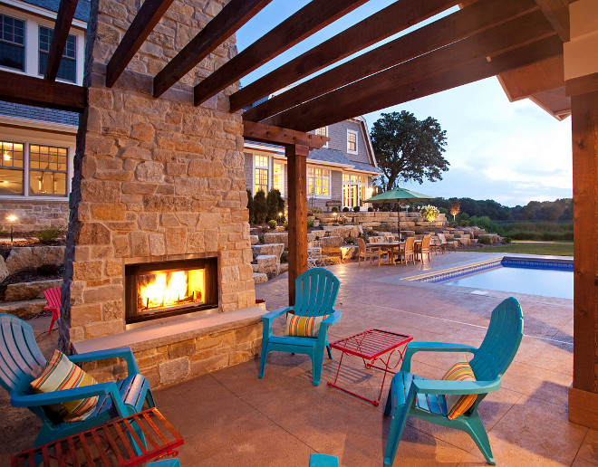 Outdoor fireplace and pergola. Outdoor patio features stone fireplace and pergola. #Pergola #outdoorfireplace #stonefireplace outdoor-fireplace-and-pergola Hendel Homes