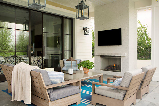 Outdoor patio with painted brick fireplace. Outdoor patio with painted brick fireplace in a soft, creamy white color. #Outdoor #patio #paintedbrickfireplace #softwhite #creamywhite Matt Morris Development