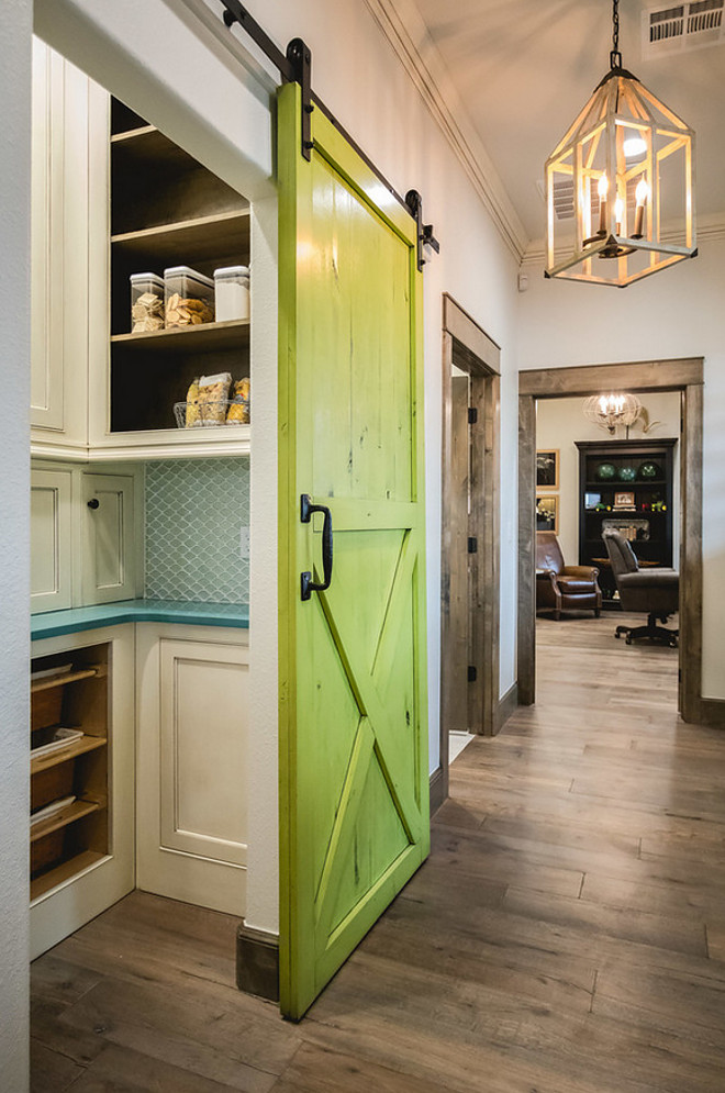 Benjamin Moore Douglas Fir. Painted Barn Door. This green barn door paint color is Benjamin Moore Douglas Fir with a charcoal oil base glaze. Butler's pantry with painted barn door. Painted Barn Door in a vibrant green color. Painted Barn Door. Painted Barn Door #PaintedBarnDoor #BarnDoor #BenjaminMooreDouglasFir Alicia Zupan