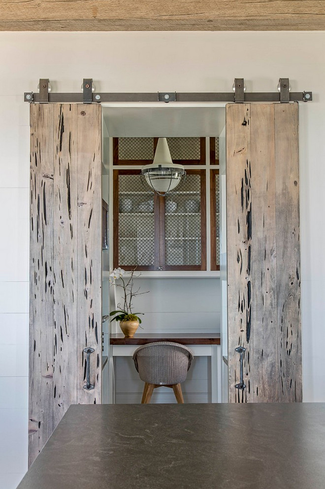Pecky Cypress Barn Door. Barn Door. The kitchen features a Pecky Cypress Barn Door leading to butler's pantry. pecky-cypress-barn-door #PeckyCypress #BarnDoor #kitchen #KitchenBarnDoor #PeckyCypressBarnDoor Herlong & Associates Architects + Interiors