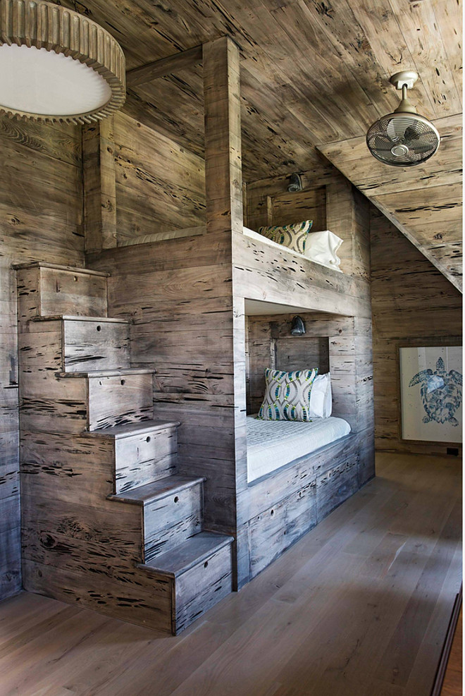 The bunk beds and stairs were custom designed and made of reclaimed Pecky Cypress wood. Rustic bunk beds. #bunkroom #pecycypress #rustic #bunkbeds #bunkroom pecky-cypress-bunk-room Herlong & Associates Architects + Interiors