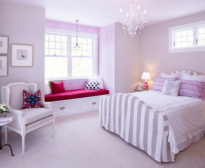 Pink Bedroom. The girl's bedroom has a built-in window seat and warm and colorful wallpaper creating a vignette the moment you walk in. Pink Bedroom. Pink Bedroom with striped gray bed. #PinkBedroom pink-bedroom Hendel Homes