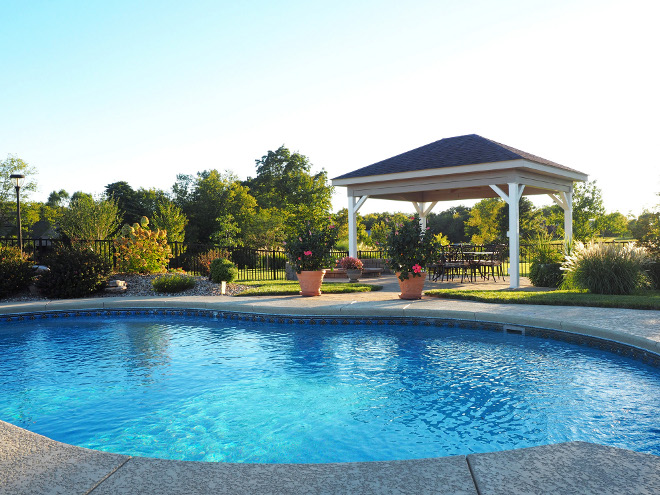 Pool. Pool. Vinyl liner pool – 18x36, irregular shape with a built-in seat inside the pool and deck jets that create fountains into the pool. #pool Home Bunch Beautiful Homes of Instagram wowilovethat