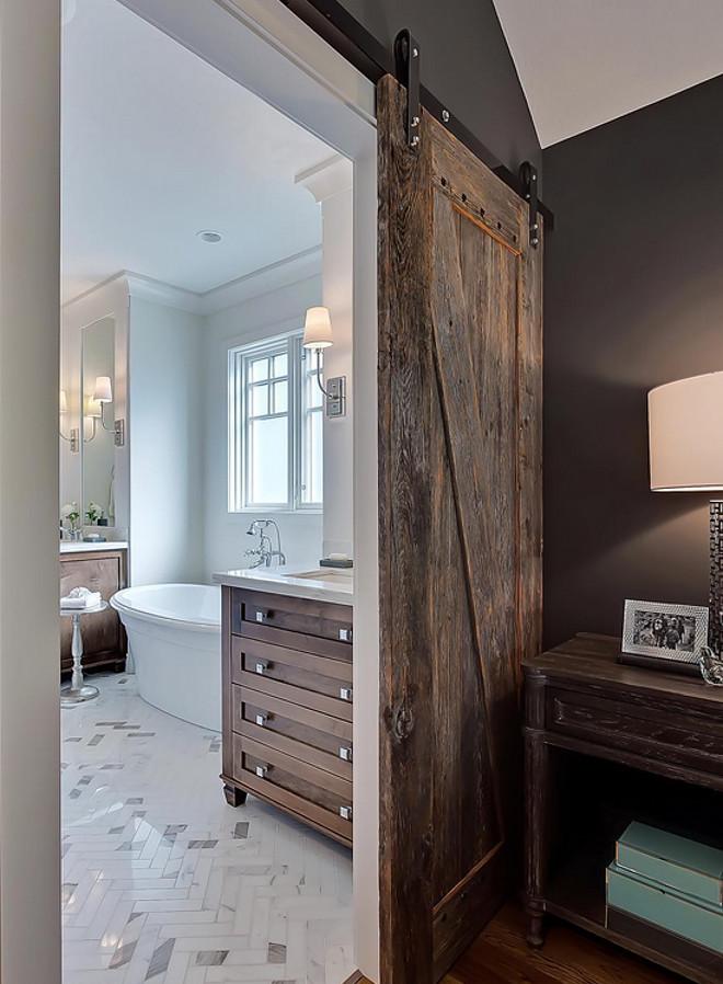 Reclaimed Wood Barn Door. The reclaimed wood barn door is made from local barn wood. The barn door hardware is from Richelieu. Reclaimed Wood Barn Door. Reclaimed Wood Barn Door #ReclaimedWoodBarnDoor #ReclaimedBarnDoor #ReclaimedWood #BarnDoor reclaimed-wood-barn-door Veranda Interior via Instagram.