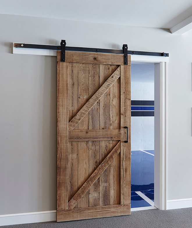 Rustic Barn Door. The custom barn door is made of reclaimed white oak. Rustic Sliding Barn Door. Reclaimed wood Rustic Sliding Barn Door. Rustic Sliding Barn Door #RusticSlidingBarnDoor #RusticBarnDoor #SlidingBarnDoor #Reclaimedwoodbarndoor #barndoor #slidingdoor #barndoorhardware #diy rustic-barn-door Hendel Homes