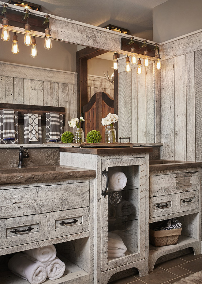 Rustic Bathroom. Rustic Bathroom with relacimed barn hand hewn and rough sawn wood cabinet and shiplap. rustic-bathroom #RusticBathroom #rusticinteriros #rustic #Bathroom #relacimedbarnwood #reclaimedwood #handhewn #roughsawn #wood #cabinet #shiplap Mike Schaap Builders. Benchmark Wood Studio Inc. Images by Ashley Avila Photography.
