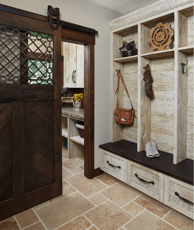 Rustic mudroom. Rustic mudroom with barn hand hewn and rough sawn wood cabinet and shiplap. Notice the incredible design on the barn door. Rustic mudroom with #barn hand hewn and rough sawn wood #cabinet and #shiplap. Notice the incredible design on the #BarnDoor. #Design by @mikeschaapbuilders and Benchmark Wood Studio Inc. #Pic by @ashleyavilaphotography. rustic-mudroom